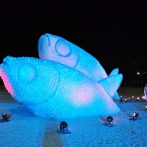 Glowing Fish Sculptures Made From Recycled Bottles