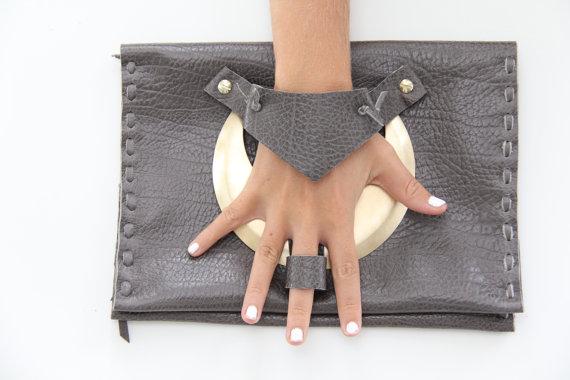 Knuckle and Finger clutch handbag