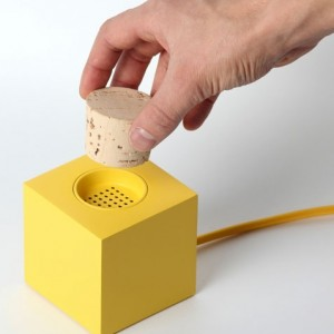 norwegian duo from skrekkøgle have developed 'plugg' - a prototype DAB radio, a result of exploring physical and metaphorical interactions with digital devices. the brightly colored geometric box form houses a maze of electronics allowing the radio to switch on and off based on removal of the cork covering the speaker.