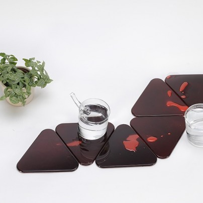 Fish coasters reveal koi when heated