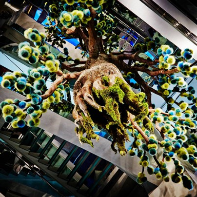 Suspends fur tree inside fendi pop-up boutique in tokyo
